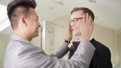 4K Young gay couple getting ready for wedding day share a kiss Stock Footage