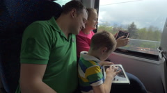 Family traveling by train and using digital tablets Stock Footage