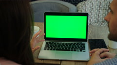 Young people using laptop pc with green screen for internet and email in cafe Stock Footage