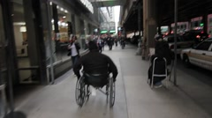 Disabled man going down the street Stock Footage
