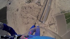 Skydiver parachuting in above arizona. Scenery. Adrenaline. Sands. Sunny day Stock Footage