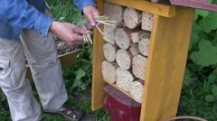 Gardener making insect hotel Stock Footage