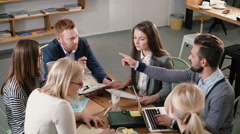 Creative business team at the table in a modern startup office. Male leader Stock Footage