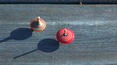 Two multicolored wooden spins whirligigs Stock Footage