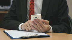 Man sitting writing the text using the smartphone Stock Footage