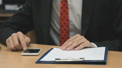 Man looking at the photos using cellphone indoors Stock Footage
