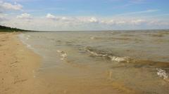 Little girl walks on sandy beach, Jurmala, Latvia Stock Footage