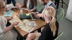 Creative business team at the table in a modern startup office. Female leader Stock Footage