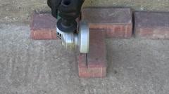 Builder cutting brick, 4K Stock Footage