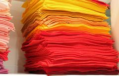 Colored pieces of felt for sale in the hobby market stall Stock Photos