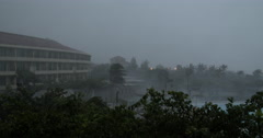 Heavy Rain And Powerful Winds Blow Across Hotel Resort During Hurricane Stock Footage