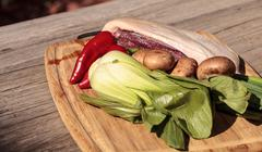 Natural raw duck breast with organic veggies Stock Photos