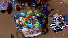 Africa woman selling goods in city market - Guinea Africa Stock Footage