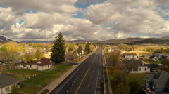 Aerial-Flying over newly paved empty main street rural town cloudy Stock Footage