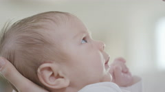 4K Close up portrait of new mother holding cute baby daughter at home Stock Footage
