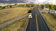 Aerial-Flying over road construction equipment on cloudy morning rural town Stock Footage