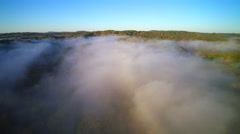 Aerial footage of fog over Trail of Tears state park in Missouri Stock Footage