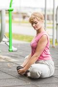 Active woman stretching warming up. Exercise. Stock Photos