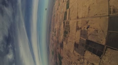 Professional parachute jumper open parachute above arizona. Scenery. Horizon Stock Footage