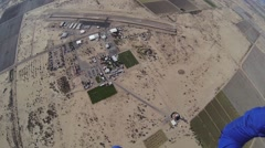 Professional parachute jumper parachuting above arizona. Scenery. Height Stock Footage