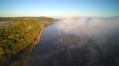 Aerial flying along bank of the Mississippi River with fog Stock Footage