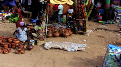 Shop of pots made of mud in street city market - Guinea Africa Stock Footage
