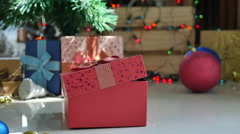 Cute tabby kitten playing in a gift box with Christmas decoration,slow motion Stock Footage