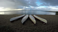 4 upturned kayaks on shore, 4K Stock Footage