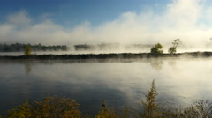 Fog lifting off the Mississippi River Stock Footage