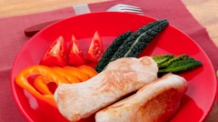 Roast turkey meat fillet steak on red plate with tomatoes Stock Footage