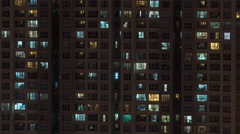 Timelapse of high-rise apartment block at night Stock Footage