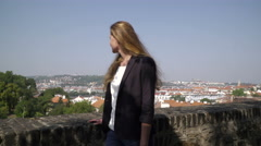 A young woman walking in the Vysehrad park in Prague Stock Footage