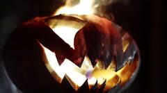 Burning pumpkin on Halloween. Looped Stock Footage
