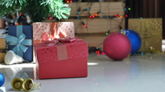 Cute tabby kitten playing in a gift box with Christmas decoration Stock Footage