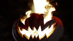 Burning pumpkin on Halloween. Looped Stock Footage