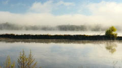 Pan across dense fog on Mississippi River Stock Footage