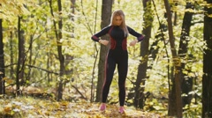 Woman doing fitness exercises outdoor. Female stretching her elbows in autumn Stock Footage