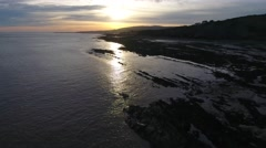 Flying over the beach towards the sunrise. Stock Footage