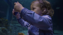 Profile Of Little Boy Taking A Photo With Smart Phone At Aquarium Stock Footage