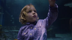 Little Boy Holds Phone And Takes Video Of Himself And Fish Swimming In Aquarium Stock Footage