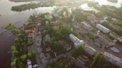 Sunset aerial shot of the Finnish town of Savonlinna with the surrounding lake Stock Footage