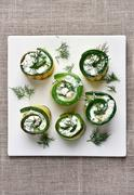 Zucchini stuffed with curd cheese, top view Stock Photos