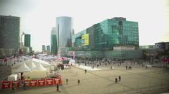 People walking near street fair, enjoying urban view, modern business buildings Stock Footage