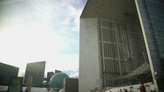 View on Grande Arche de la Defense and modern glass buildings in Paris, France Stock Footage