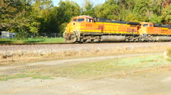 Beautiful Fall scene with train passing through Stock Footage