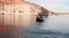 Pontoon boat approaches shore HD Stock Footage