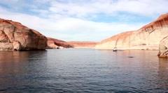 Pontoon boat drives across lake HD  Stock Footage