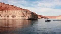 Pontoon boat driving across lake HD Stock Footage