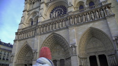 Notre-Dame de Paris, famous Gothic cathedral attracting millions of tourists Stock Footage