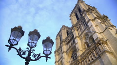 Antique streetlight and Notre-Dame cathedral, sightseeing in Paris, France Stock Footage